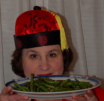 No, it isn't the pork I'm sniffing in this photo--but I couldn't find my hat so I used an older photo. I DID want you to see me in my faux Chinese regalia.