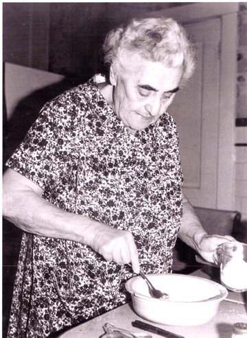Nana making cookie frosting.web